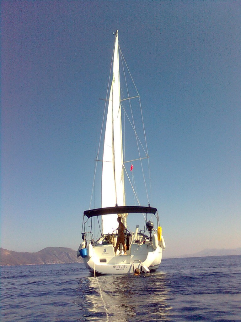Magic moments on Mamma Mia! End of October sailing. Mountains of Turkey to the left and Rhodes far back right.